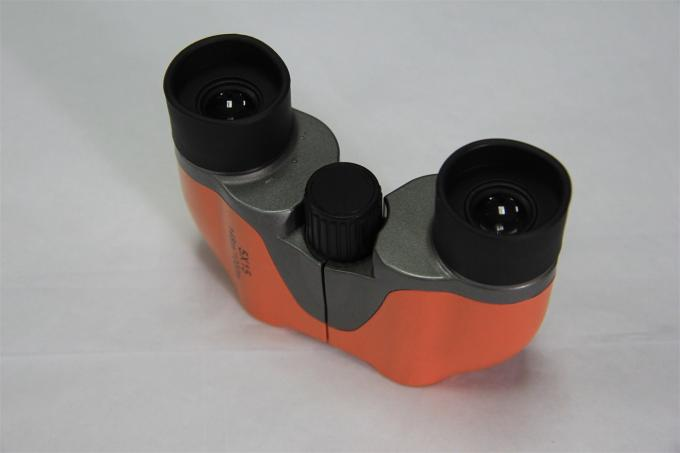 Lightweight Children's Toy Binoculars , Orange Kid Looking Through Binoculars